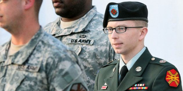 FORT MEADE, MD - FEBRUARY 23: Army Private Bradley Manning is escorted away from his Article 32 hearing...