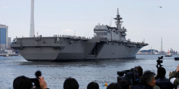 Japan Maritime Self-Defense Force's (JMSDF) latest Izumo-class helicopter carrier DDH-184 Kaga leaves...