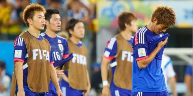 CUIABA, BRAZIL - JUNE 24: A dejected Manabu Saito and Yoichiro Kakitani of Japan after defeat in the...