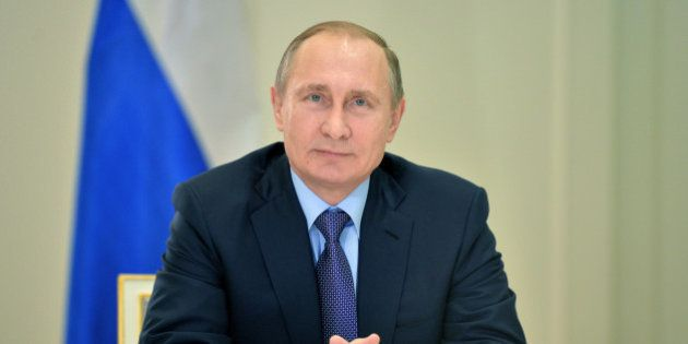 Russian President Vladimir Putin watches opening of the second power line to Crimea during a live video...