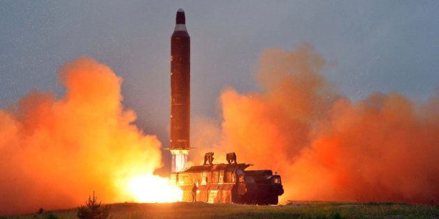 A test launch of ground-to-ground medium long-range ballistic rocket Hwasong-10 in this undated photo...