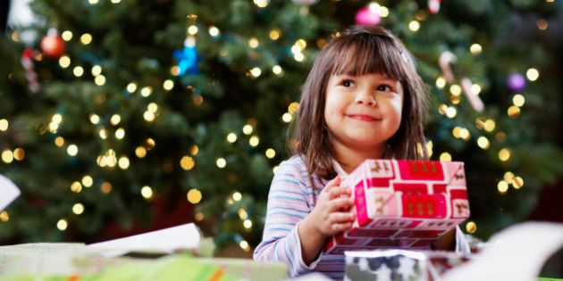 Girl Holding Christmas