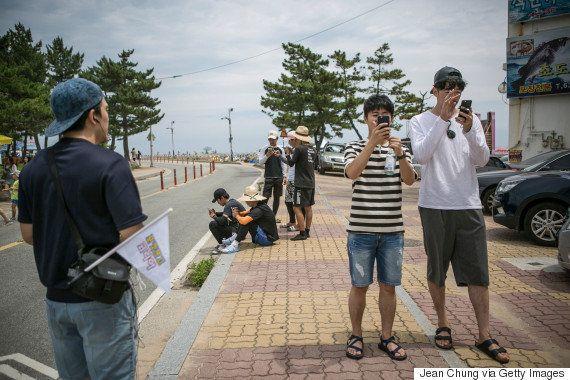 「ポケモンGO」韓国の街に観光客が殺到 未対応なのになぜプレイ可能?(動画・画像集)