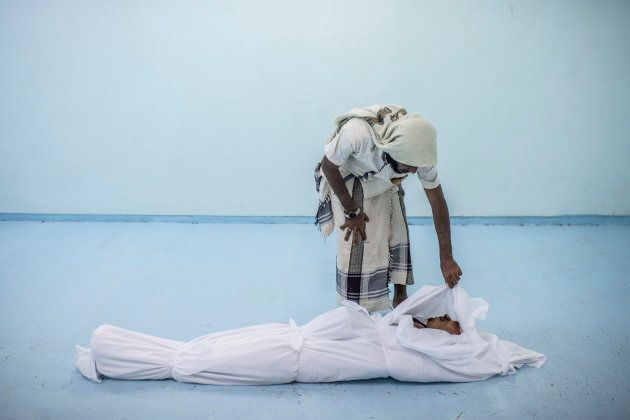 Al KHAWKHAH, YEMEN - SEPTEMBER 22: The body of a Yemeni fighter killed in Hodeidah is attended to by...