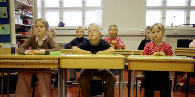 Vaasa (Vasa), FINLAND: Children listen to their teacher 17 August 2005 in a primary school in Vaasa,...