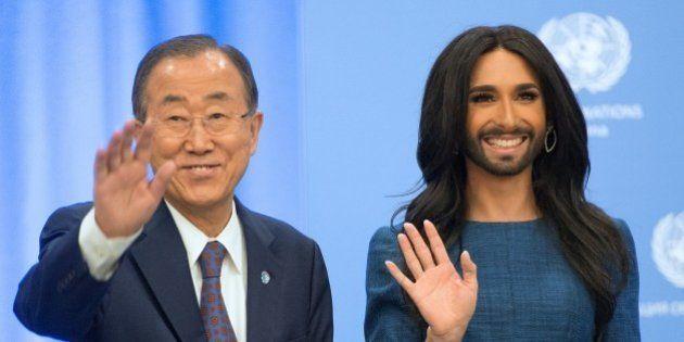 UN General Secretary Ban Ki-moon (L) and Austrian transvestite singer Conchita Wurst wave at the United...