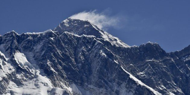 This picture taken on April 20, 2015 shows a view of Mount Everest (Background) and Nupse (Foreground)...