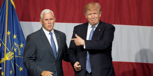 Presumptive US Republican presidential candidate Donald Trump (R) and Indiana Governor Mike Pence (L)...