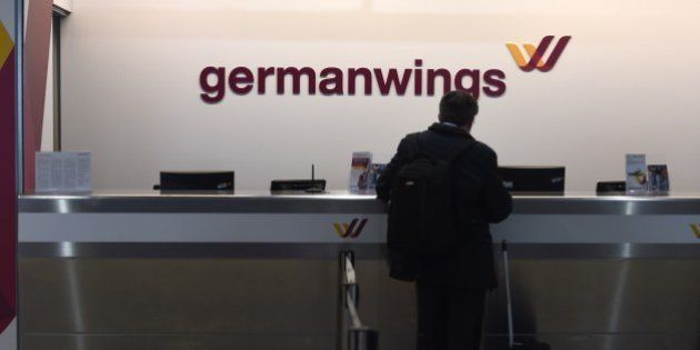 A man check in at a counter of German airline German Wings in Cologne/Bonn airport on March 24, 2015...