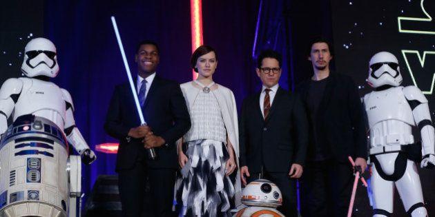 TOKYO, JAPAN - DECEMBER 10: (from left) Stormtrooper, R2-D2, John Boyega, Daisy Ridley, J.J. Abrams,...