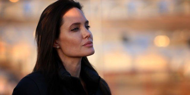 US actress and UNHCR ambassador Angelina Jolie stands during a visit to a camp for displaced Iraqis in...