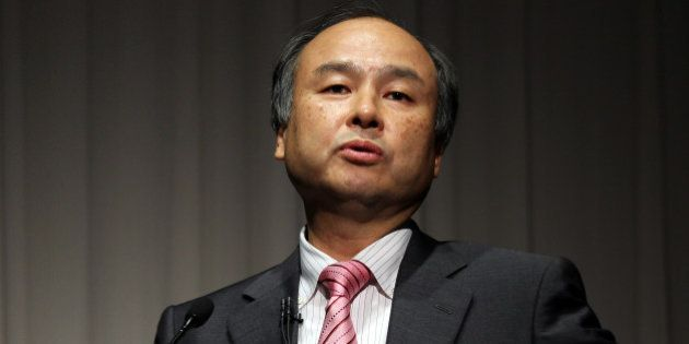 Masayoshi Son, chairman and chief executive officer of SoftBank Corp., speaks during a news conference...
