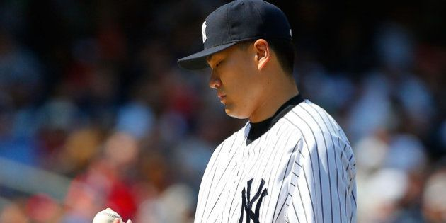 NEW YORK, NY - JUNE 22: Masahiro Tanaka #19 of the New York Yankees looks at the ball after surrendering...