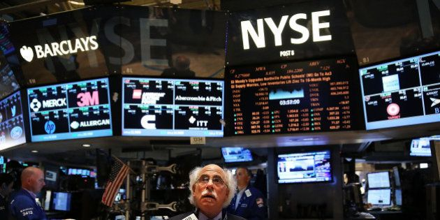 NEW YORK, NY - JUNE 20: Traders work on the floor of the New York Stock Exchange (NYSE) on June 20, 2014...