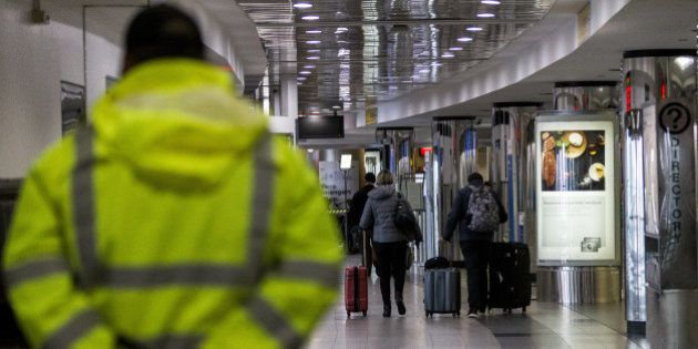 Travelers pull luggage at LaGuardia Airport (LGA) in New York, U.S., on Tuesday, March 14, 2017. A slight...
