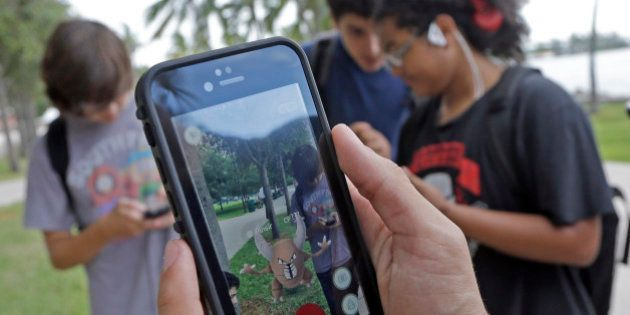 Pinsir, a Pokemon, is found by a group of Pokemon Go players, Tuesday, July 12, 2016, at Bayfront Park...