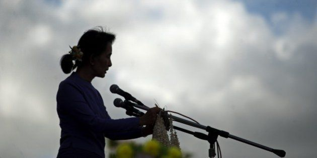 Myanmar pro-democracy leader Aung San Suu Kyi addresses supporters during a rally at Mawlamyaing, Mon...