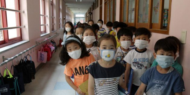 SEOUL, SOUTH KOREA - JUNE 09: Elementary school students wear masks as a precaution against the MERS...