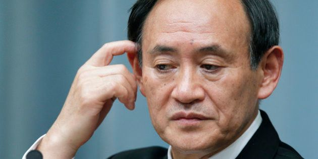 Yoshihide Suga, Japan's newly appointed chief cabinet secretary, pauses during a news conference at the...