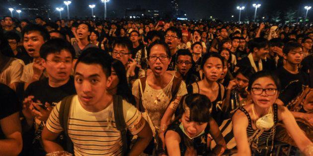 HONG KONG - OCTOBER 2: Pro-democracy protesters chant slogans outside of Hong Kong's Chief Executive...