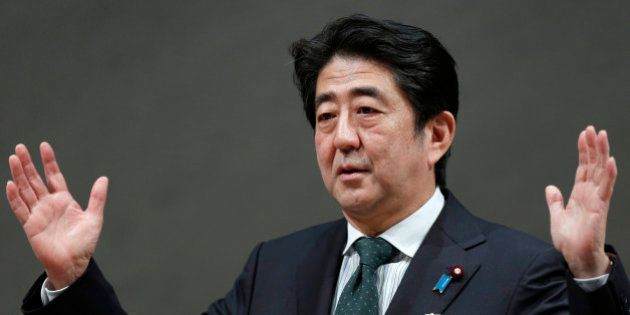 Shinzo Abe, Japan's prime minister, gestures as he speaks during a meeting at the business lobby Keidanren...