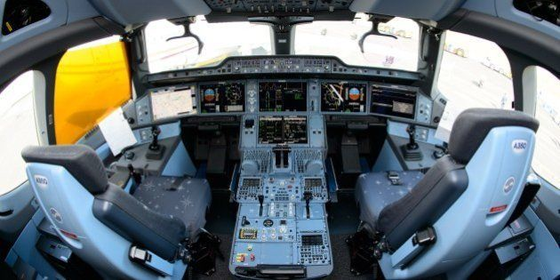 The interior view of the flight deck, or cockpit, of an Airbus A350XWB test plane is pictured at the...
