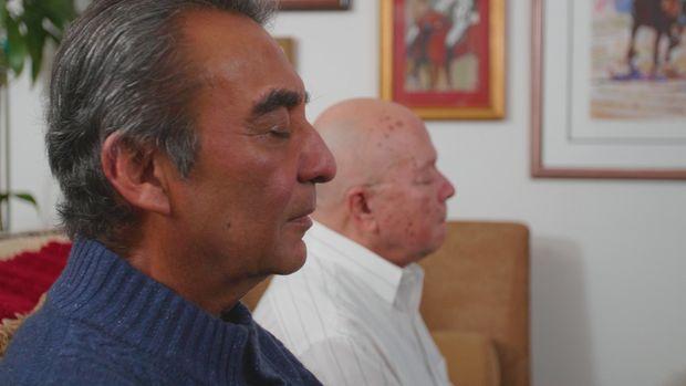 Azim Khamisa and Ples Felix pictured meditating together.