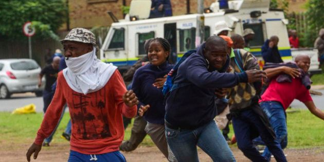 PRETORIA, SOUTH AFRICA FEBRUARY 24: (SOUTH AFRICA OUT): Protesters and police clash during the Foreign...