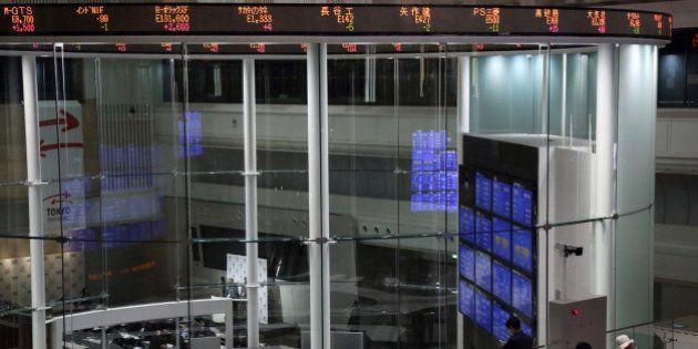 Visitors look at the trading floor of Japan Exchange Group Inc.'s Tokyo Stock Exchange in Tokyo, Japan,...