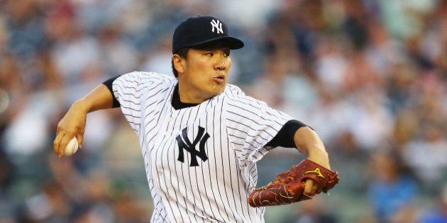 NEW YORK, NY - JUNE 17: Masahiro Tanaka #19 of the New York Yankees pitches against the Toronto Blue...