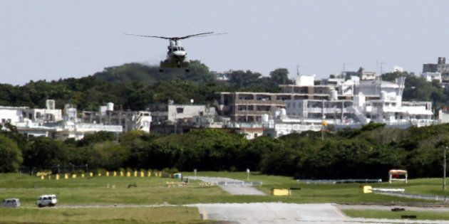 FILE - In this March 5, 2010 file photo, a U.S. Marine helicopter tries to land at Marine Corps Air Station...