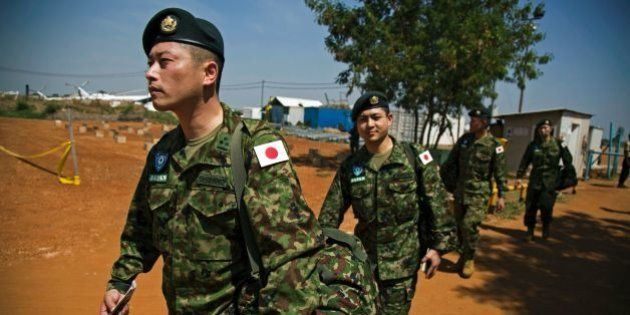 Members of the Japanese Ground Self-Defence Force (GSDF) arrive at the base at the compound of the United...