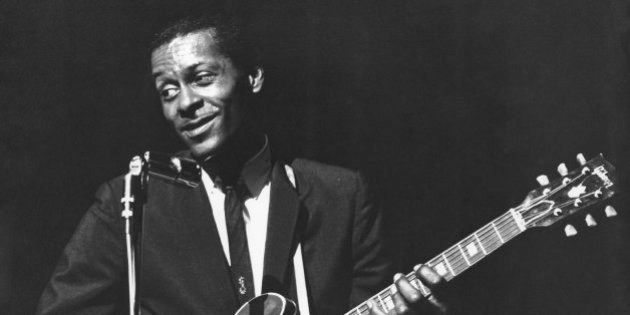CIRCA 1965: Rock and roll musician Chuck Berry performs onstage with his Gibson hollowbody electric guitar...
