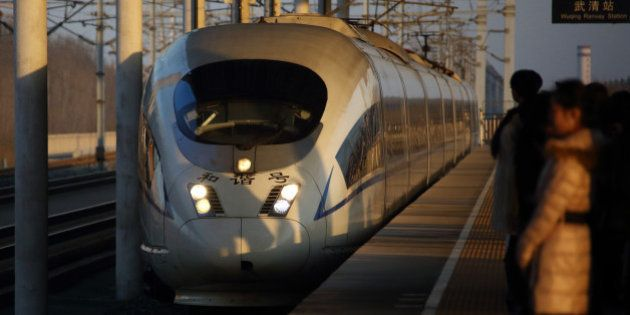 A China Railways high speed train arrives at Wuqing Railway Station in Tianjin, China, on Wednesday,...