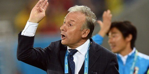 Japan's Italian coach Alberto Zaccheroni gestures during a Group C football match between Japan and Greece...