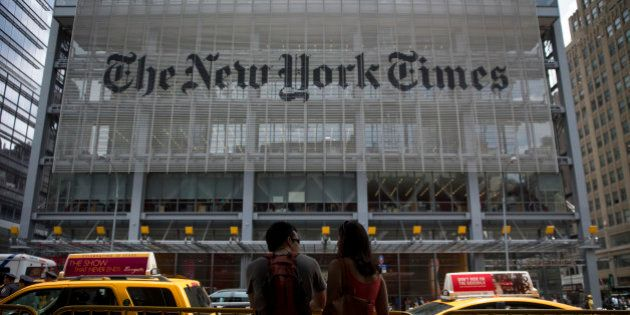 Pedestrians pass in front of The New York Times Co. offices in New York, U.S., on Wednesday, July 31,...