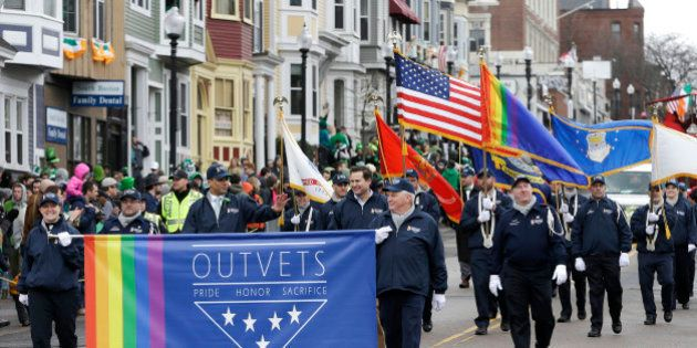 Members of OutVets, a group of gay military veterans, hold a banner and flags as they march in the St....