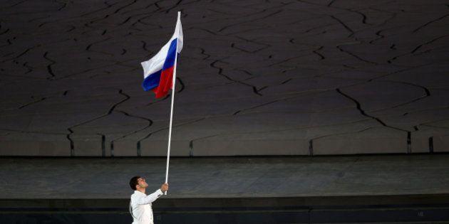BAKU, AZERBAIJAN - JUNE 12: flag bearer and wrestler, Khadzhimurat Gatcalov of Russia leads his team...