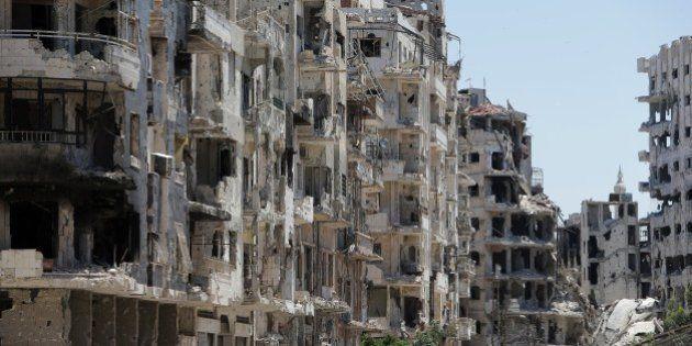 Destroyed buildings are seen in the Homs neighbourhood of Khaldiyeh, formerly held by rebel fighters...