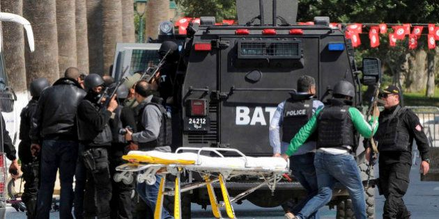 Rescue workers pull an empty stretcher after gunmen opened fire at the Bardo museum in Tunisia's capital,...