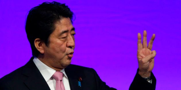 Shinzo Abe, Japan's prime minister and president of the Liberal Democratic Party (LDP), gestures as he...