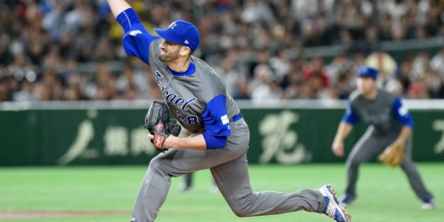 Israeli starter Josh Zeid pitches the ball in the bottom of the first inning during the World Baseball...