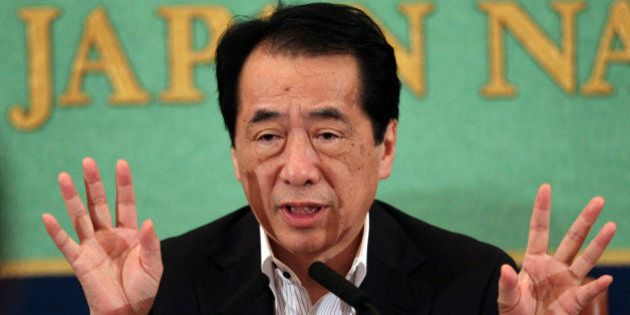 Japan's former Prime Minister Naoto Kan speaks during a press conference at the Japan National Press...