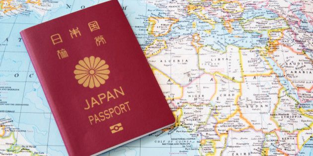 Japanese passport on a world