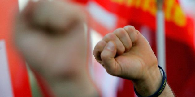 PARIS - OCTOBER 12: Protestors raise their fists on October 12, 2010 in Paris, France. French unions...