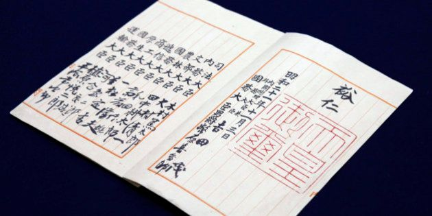 The signature and seal of the late Japanese Emperor Hirohito are seen on the replica of an official original...