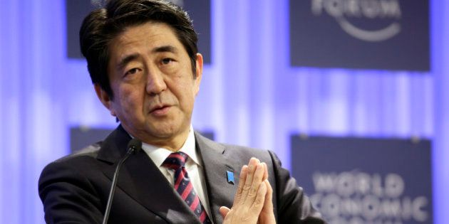 Shinzo Abe, Japan's prime minister, gestures during a session on the opening day of the World Economic...