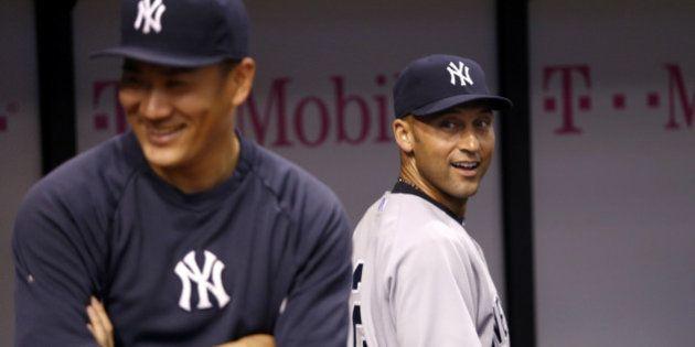 ST. PETERSBURG, FL - SEPTEMBER 16: Pitcher Masahiro Tanaka #19 of the New York Yankees and shortstop...