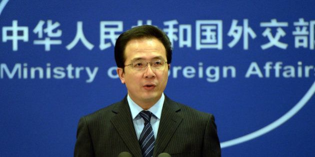 The Chinese Foreign Ministry spokesman Hong Lei talks during a press briefing in Beijing on April 8,...