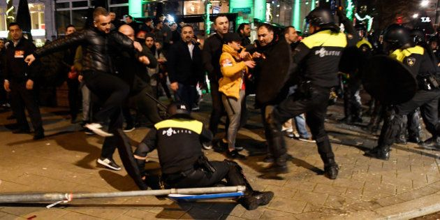 Riot police clash with demonstrators in the streets near the Turkish consulate in Rotterdam, Netherlands...